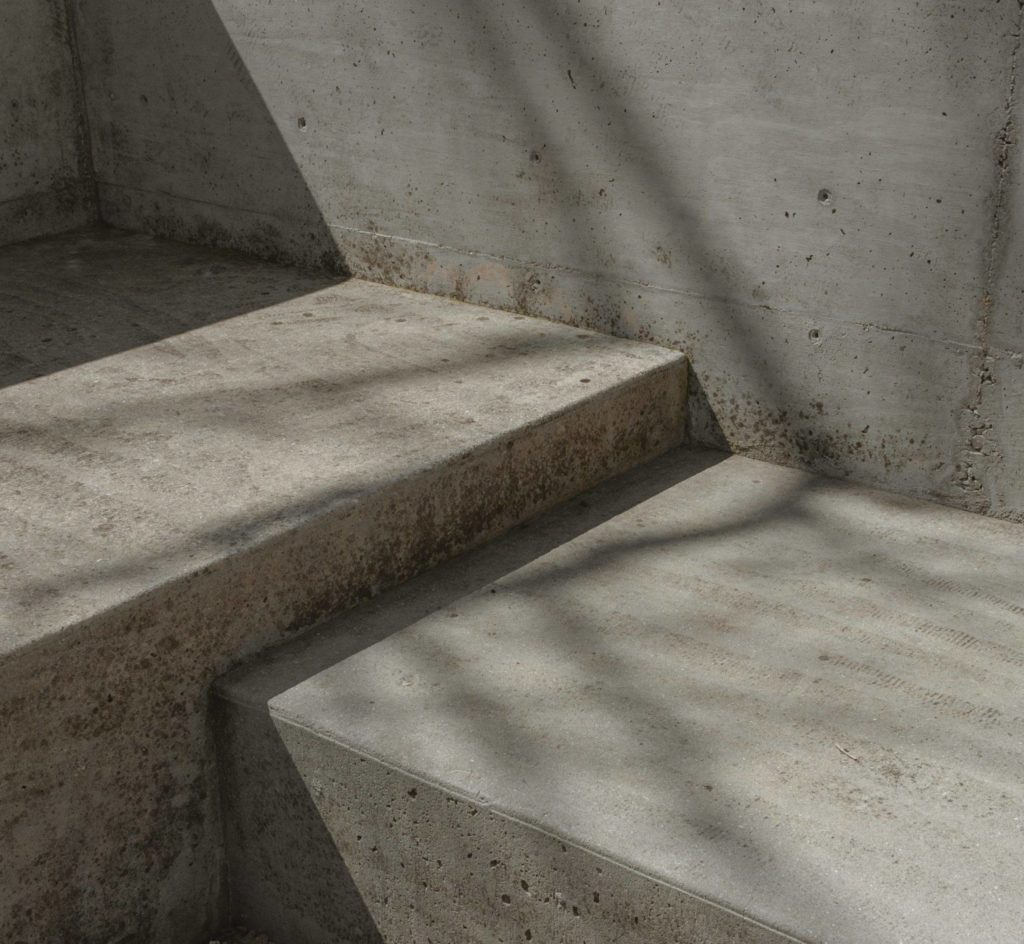 concrete steps and wall with small gouges and imperfections