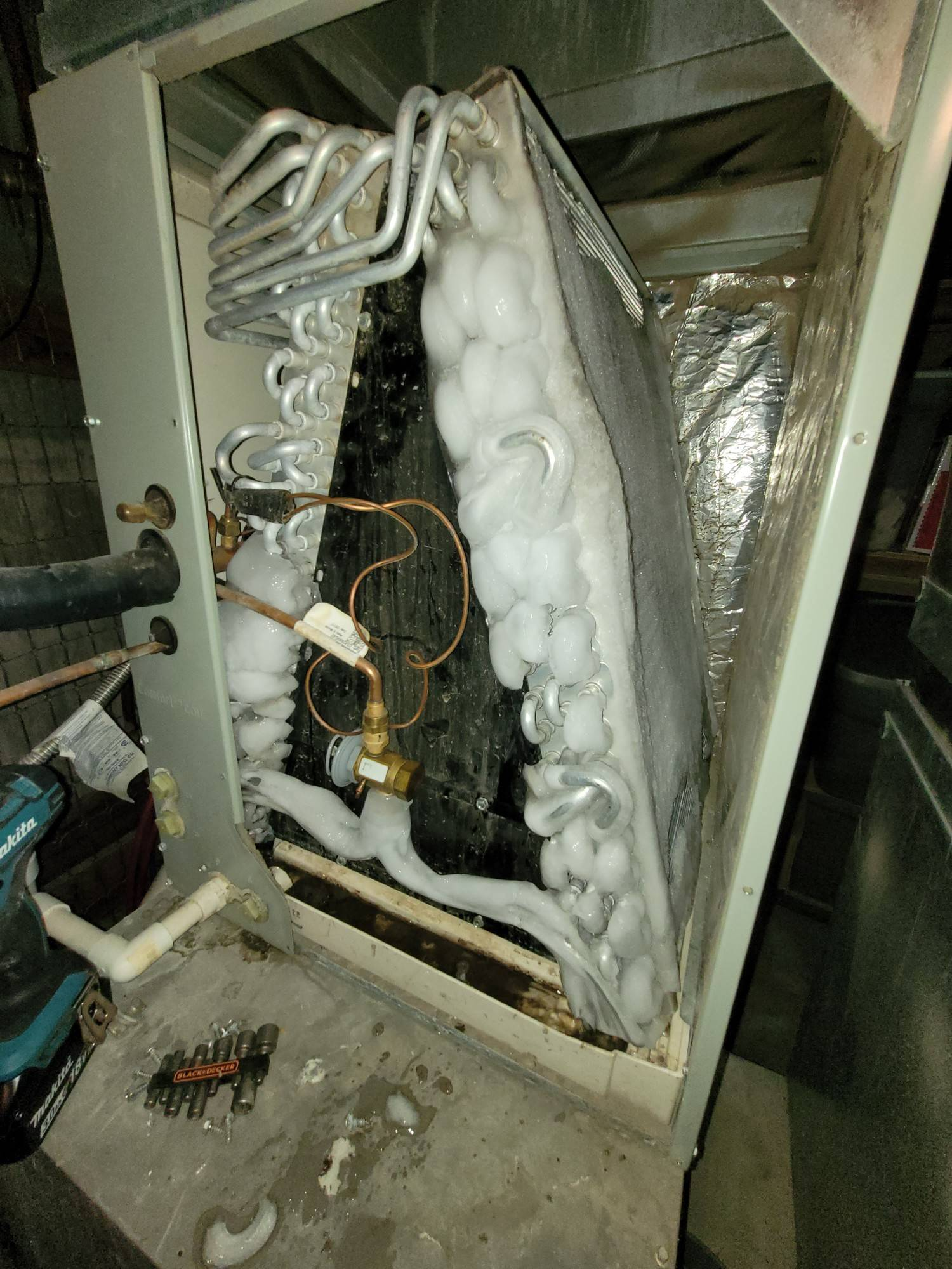 air conditioner unit with ice on it