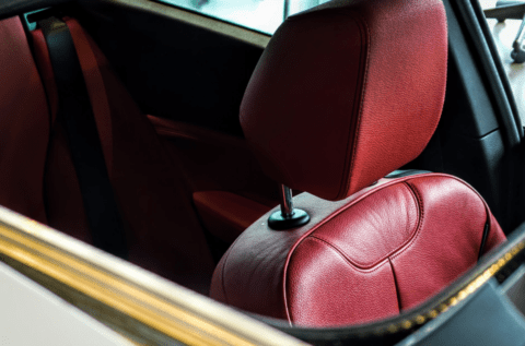 interior of a car with red leather seats