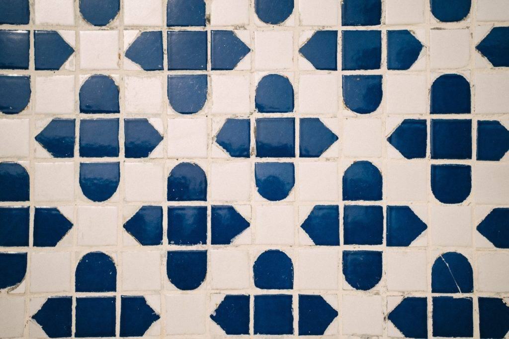 blue and white tile backsplash with white grout