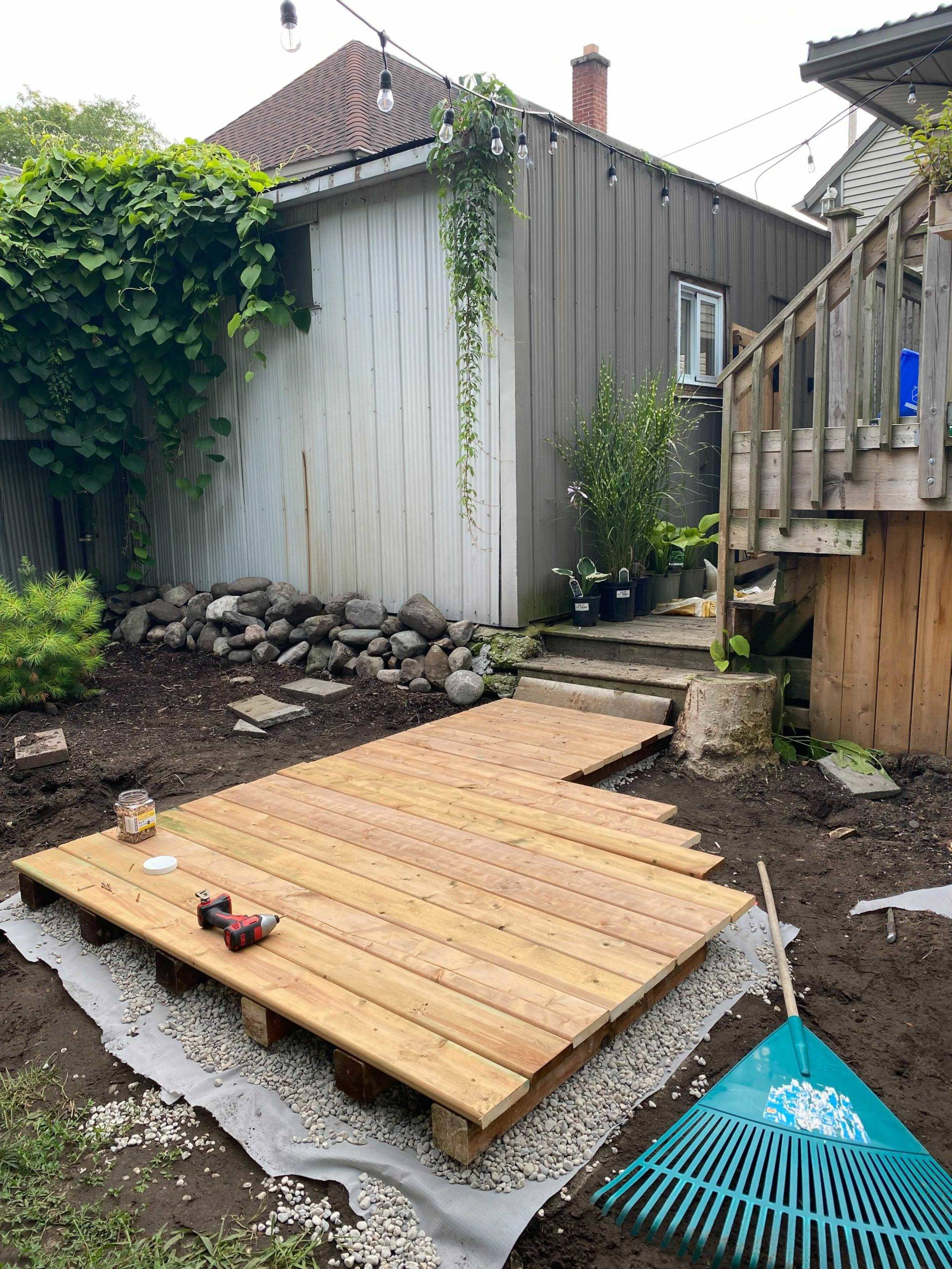completely backyard boardwalk with saw resting on top