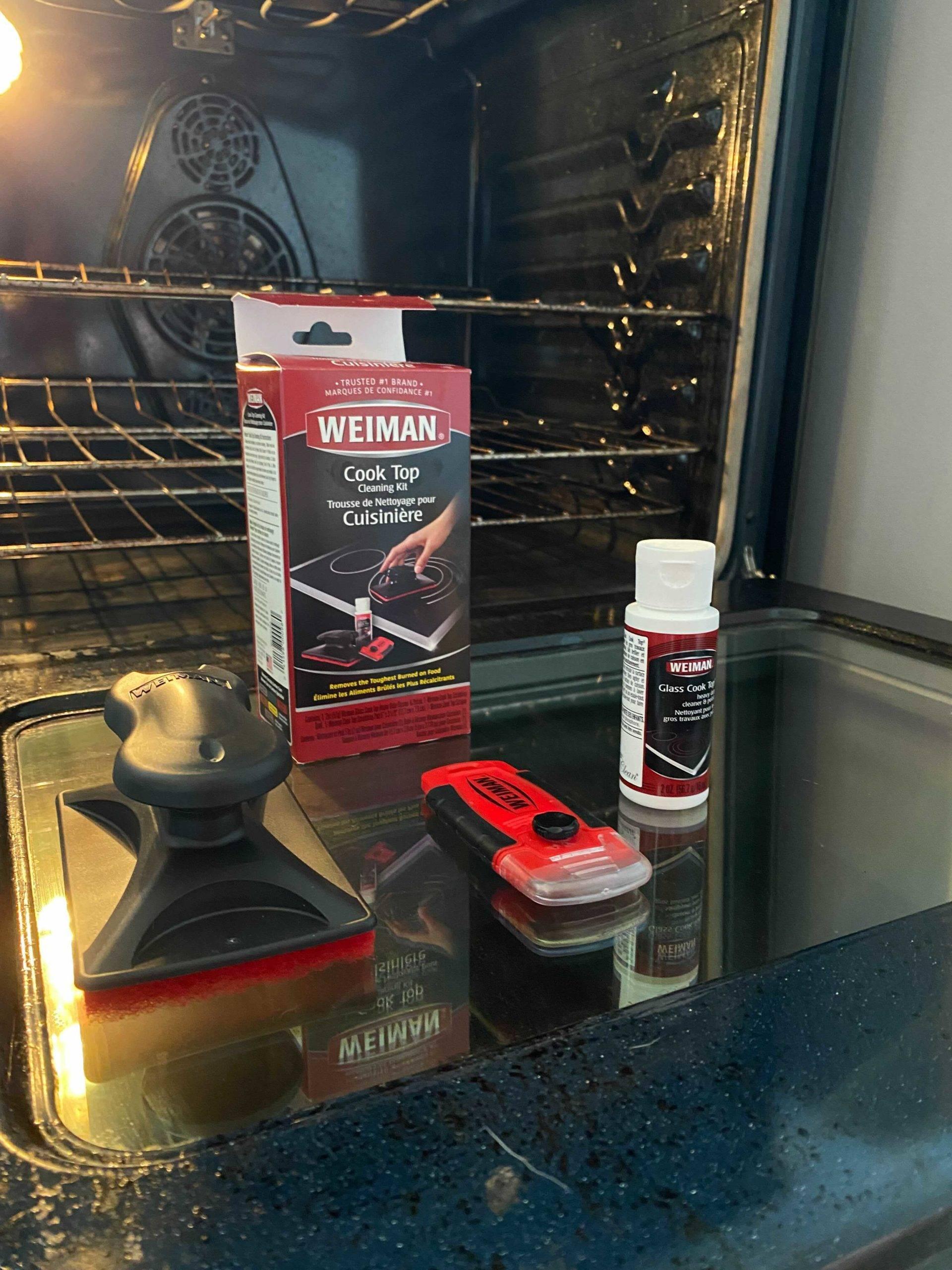 oven cleaning kit resting on open door