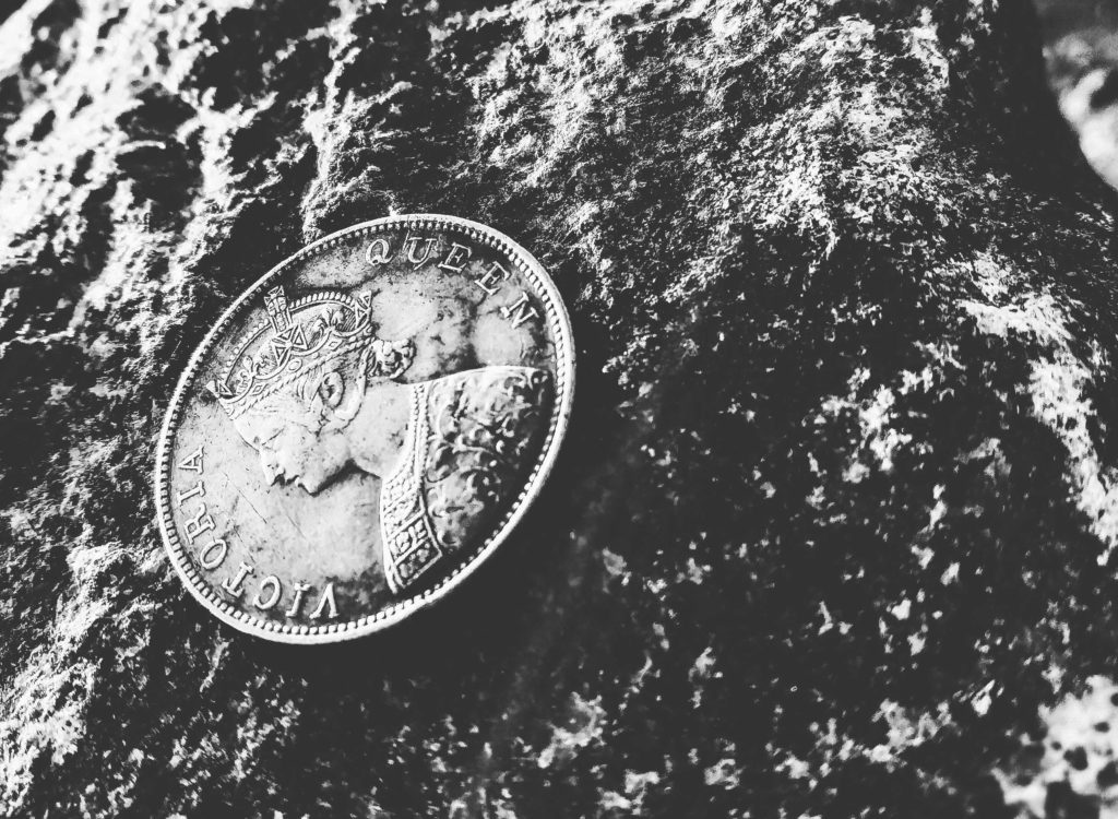 black and white image of a coin