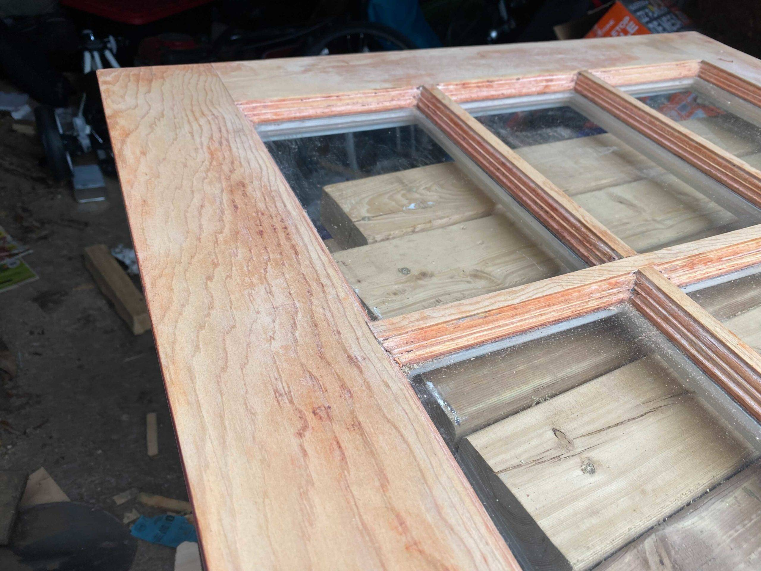window pane after sanding and stripping