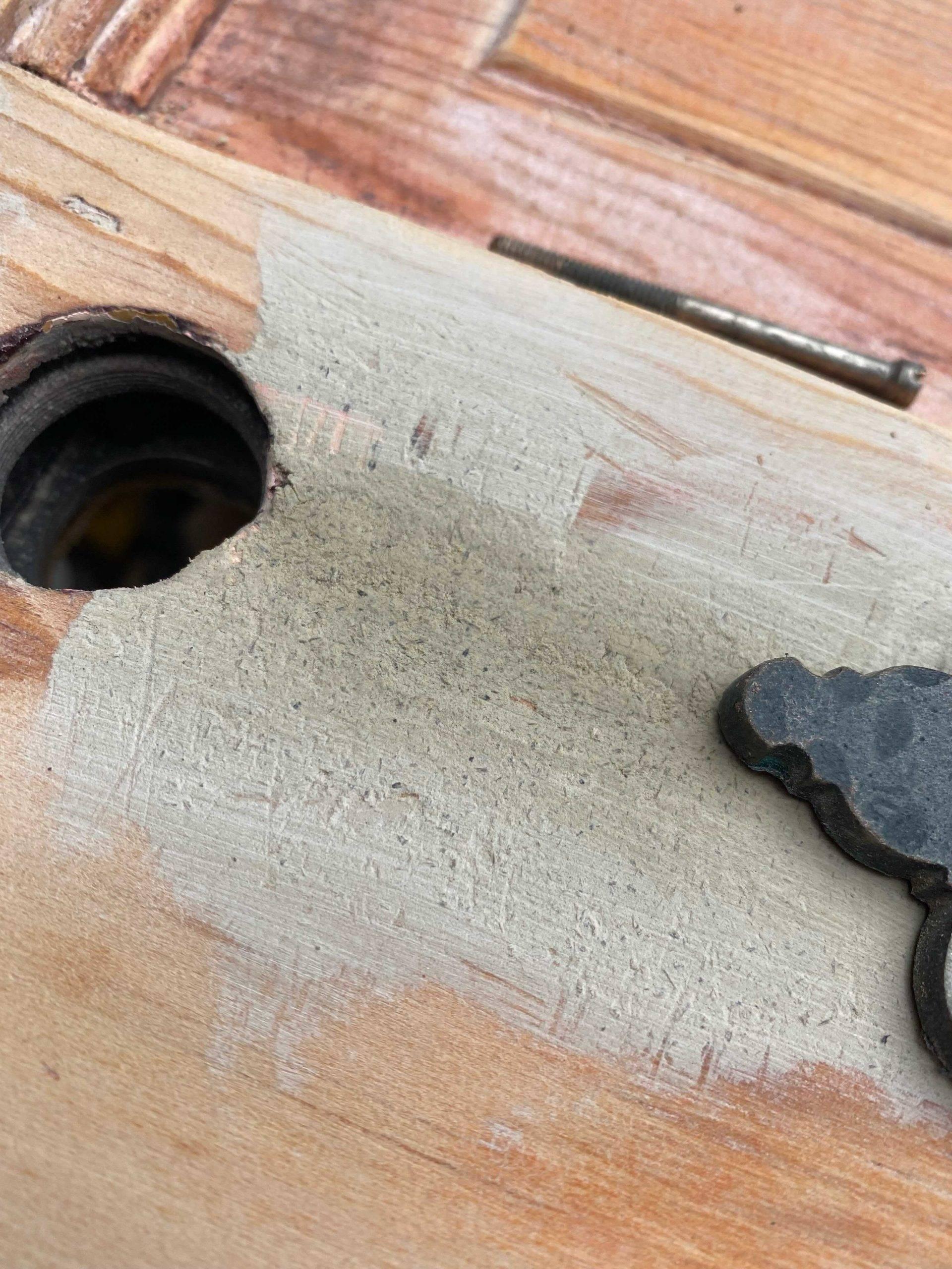 sanded down section of door
